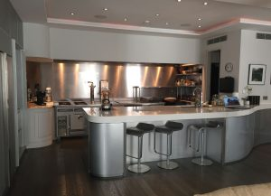 Modern kitchen with silver splashback and counter