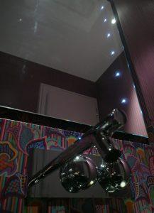 Modern bathroom mirror and sink with flower pattern walls