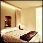Cosy bedroom with Buddha statue and golden colours