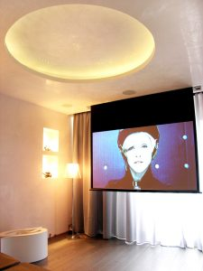 Modern cinema room with foldable screen and projector