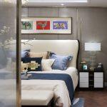 Big cosy bed in modern, eclectic bedroom