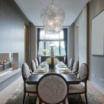 Classic style dining room with leaf shaped chandelier