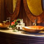 Exotic style bathroom with copper basin sinks