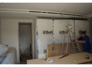 ANBM team installing furniture and ceiling for a house renovation