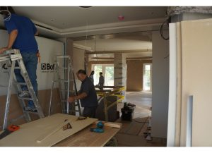 ANBM team working on the ceiling for house construction