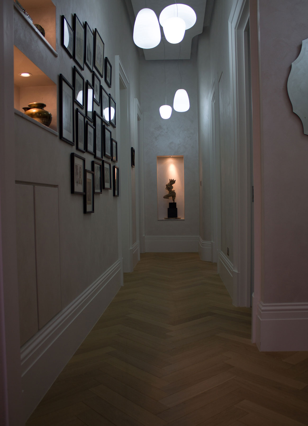 Corridor with modern lighting and sculpture