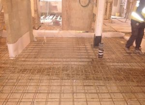 Annabella Nassetti team cementing over a house's floor