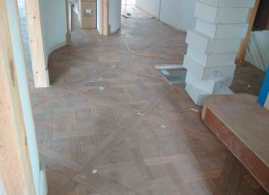 ANBM changing the flooring for a house renovation