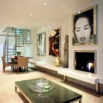 Contemporary living room with fireplace and art