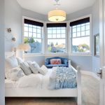 Blue bedroom with bay window