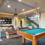 Play room with pool table and projector screen