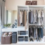 Walk-in wardrobe with dressing table and mirror