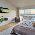 Modern bedroom with flat TV and view on San Diego Bay