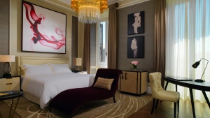 Elegant modern hotel room featuring a chaise longue