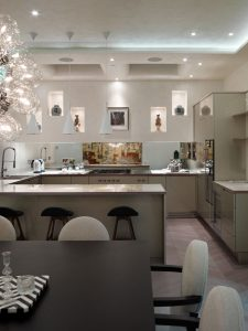Modern kitchen & dining room with Asian figurines & vases