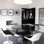 Modern dining room with glass round table and bar