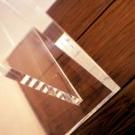 Close shot of a glass sculpture on wooden furniture