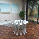 Modern glass round table in dining room