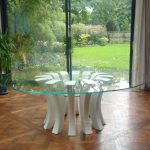 White & glass round table with garden view
