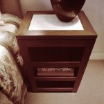 Wooden bedside table with shelves