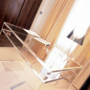 Transparent glass desk with matching lamp