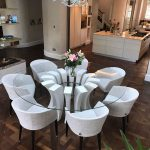 Round glass dining table with white frame in dining room
