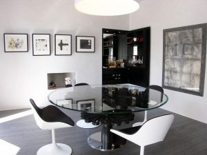 Modern dining room with drinks cabinet and glass round table