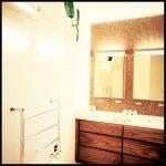 Mosaic bathroom with wooden storage