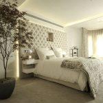 Beige bedroom with upholstered headboard