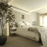 Beige bedroom with upholstered headboard