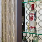 Drinks cabinet with glass shelves & Smirnoff Vodka