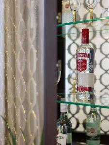 Drinks cabinet with glass shelves & Smirnoff Vodka