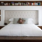 Modern bedroom design with embedded wall storage
