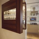 Wooden cupboard for glasses with window