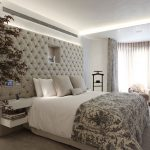 Beige master bedroom with tech-controlled upholstered headboard