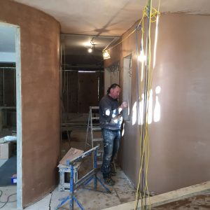 Plastering walls as part of renovation project