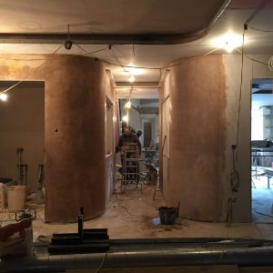 Corridor under construction with plastered walls