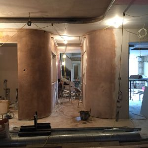 ANBM team plastering curved walls