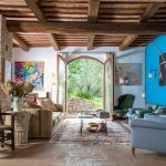 Rustic living area with exposed beams and stone floor