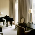 Lounge room including grand piano