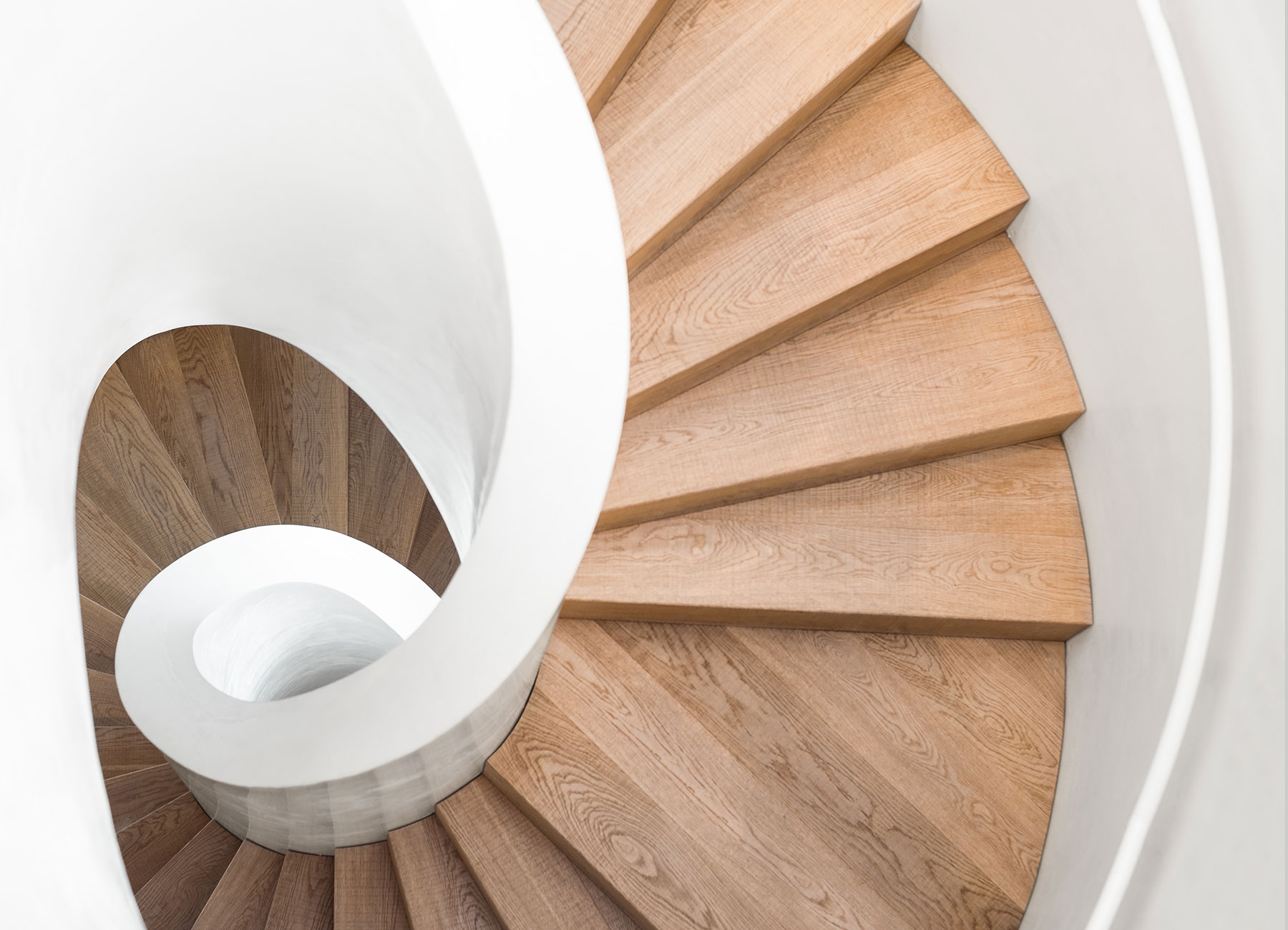Spiral staircase with wooden steps