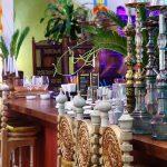 Hookahs stood on table in modern Indian restaurant