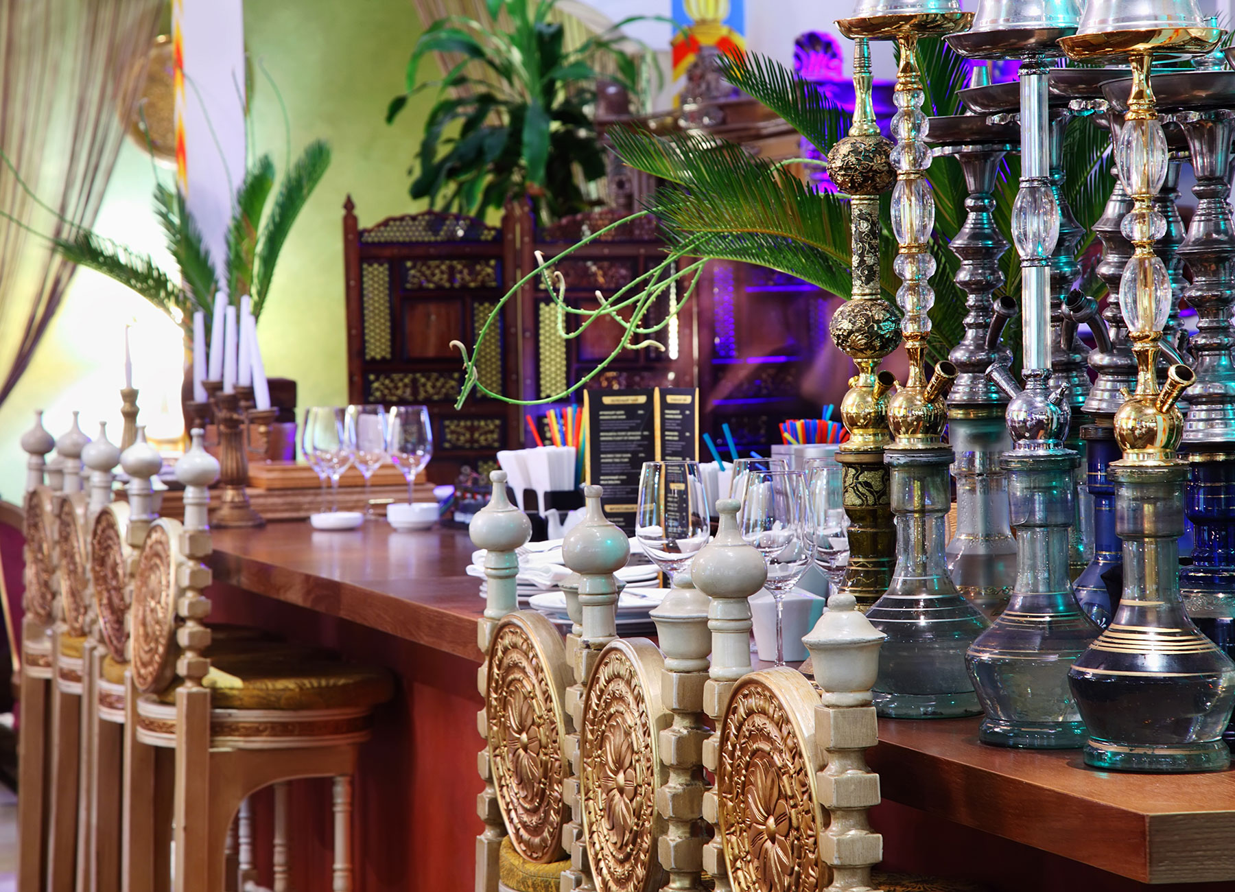Hookahs stood on table in modern Indian restaurant