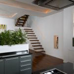 Modern living space with stylish wooden staircase
