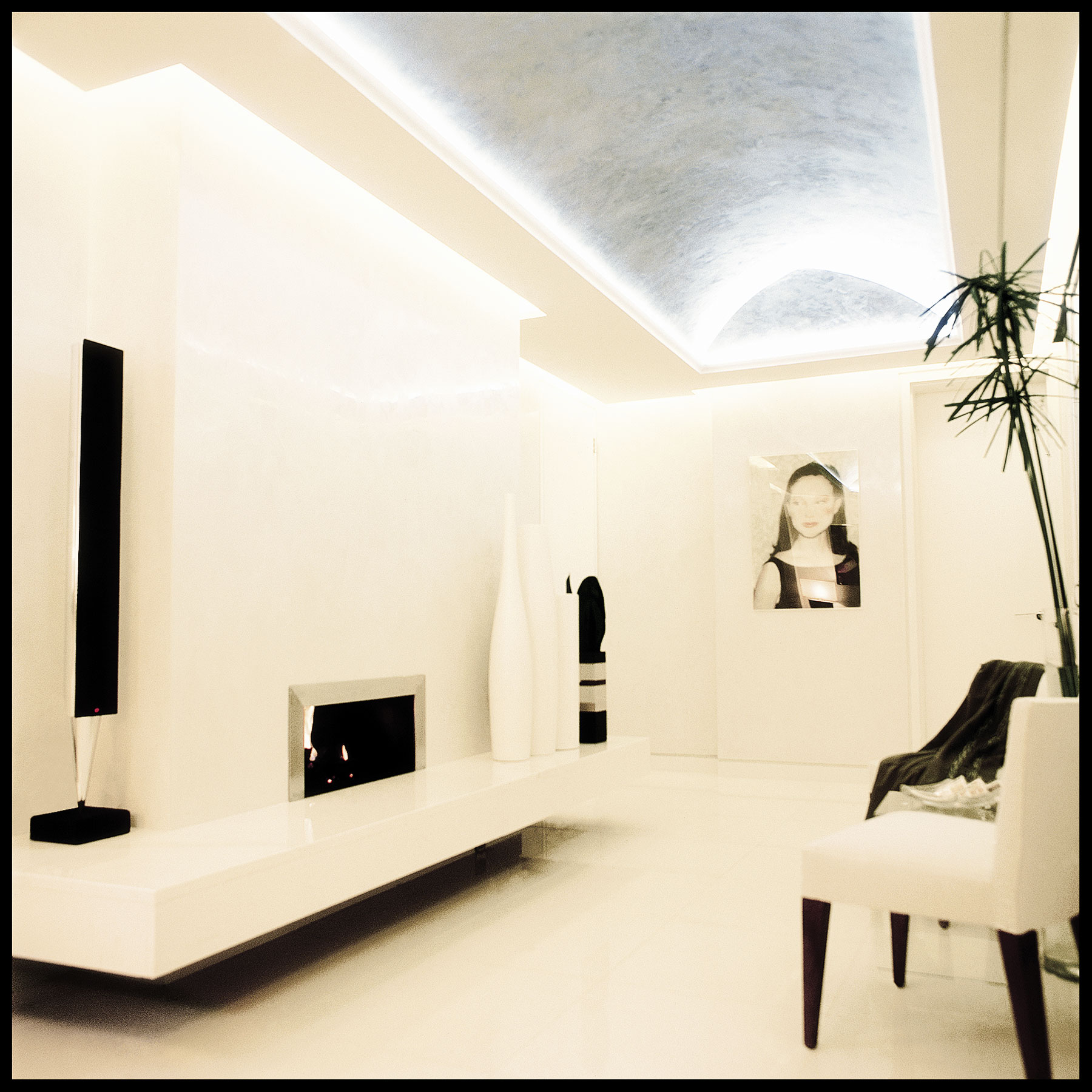 Modern living area with fireplace and vaulted ceiling