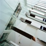 Glass staircase with chrome surrounds