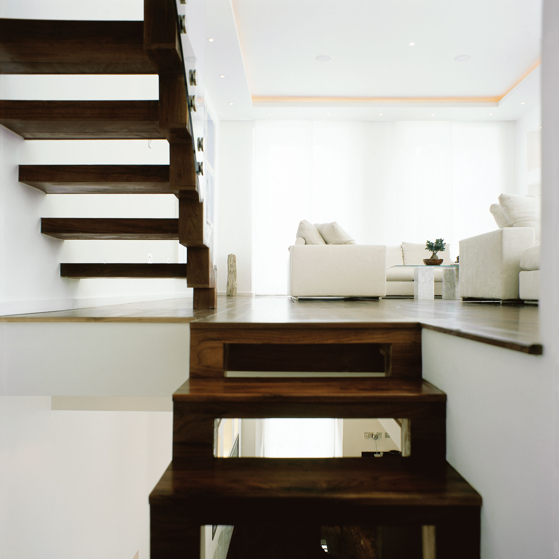 Wooden staircases leading to living area